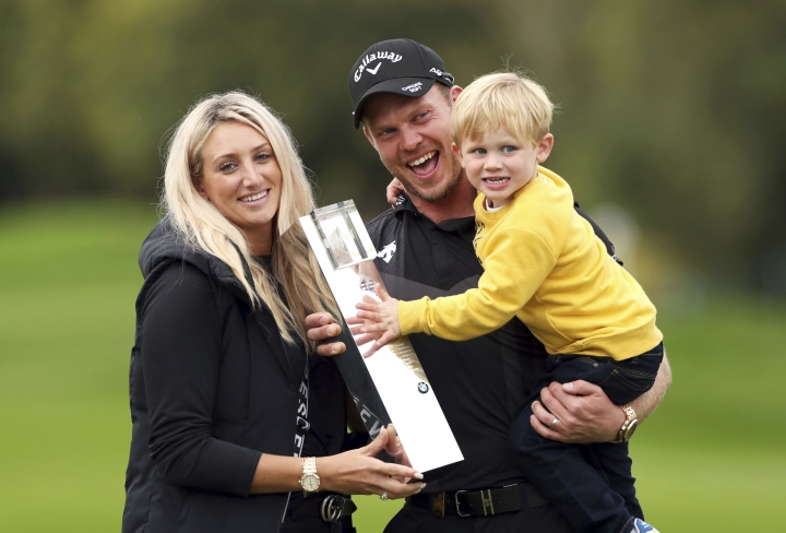 England's Danny Willett, his wife Nicole and son Zachariah James pose with the trophy after winning the PGA Championship at Wentworth Golf Club, Wentworth, England, Sunday Sept. 22, 2019. (Bradley Collyer/PA via AP)