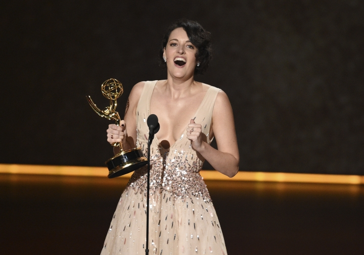 """Phoebe Waller-Bridge accepts the award for outstanding writing for a comedy series for """"Fleabag"""" at the 71st Primetime Emmy Awards on Sunday, Sept. 22, 2019, at the Microsoft Theater in Los Angeles. (Photo by Chris Pizzello/Invision/AP)"""