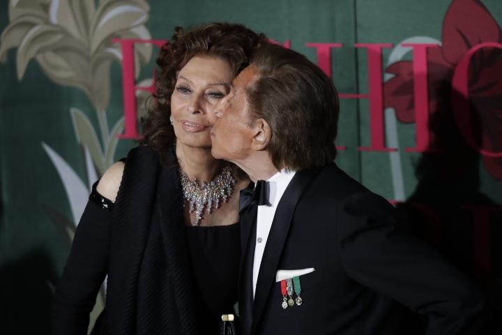 Designer Valentino Garavani, right, kisses actress Sophia Loren upon arrival at the Green Carpet Fashion Awards in Milan, Italy, Sunday, Sept. 22, 2019. (AP Photo/Luca Bruno)