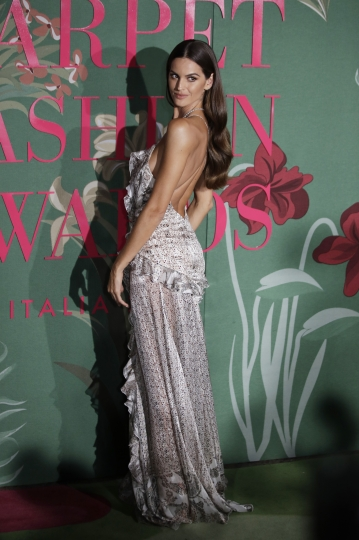 Model Izabel Goulart poses for photographers upon arrival at the Green Carpet Fashion Awards in Milan, Italy, Sunday, Sept. 22, 2019. (AP Photo/Luca Bruno)