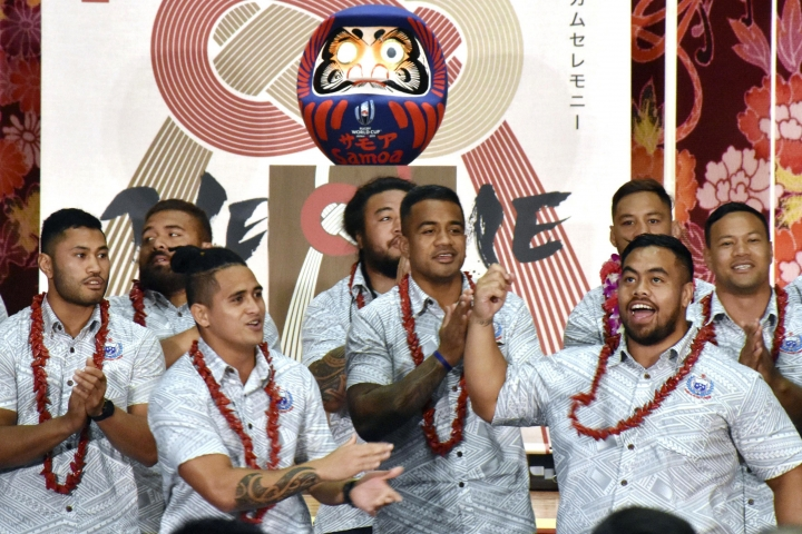 FILE - In this Sept. 16, 2019, file photo, Samoa's rugby team players perform during a welcome ceremony for their team in Yamagata, northern Japan, ahead of the Rugby World Cup in Japan. Samoan rugby players will wear skin suits to cover their traditional Pacific Islander tattoos during some training sessions at the World Cup in order not to offend their Japanese hosts.(Kyodo News via AP, File)