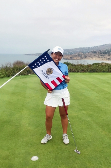 This Aug. 23, 2019, photo provided by Greg Borchers shows Kayli Lucas posed on the 18th green at Trump National in Los Angeles, where she was part of an elite group of juniors from The First Tee to spend a day with Nick Faldo. Kayli's next stop is to play with pros this week at Pebble Beach in a PGA Tour Champions event. (Greg Borchers via AP)