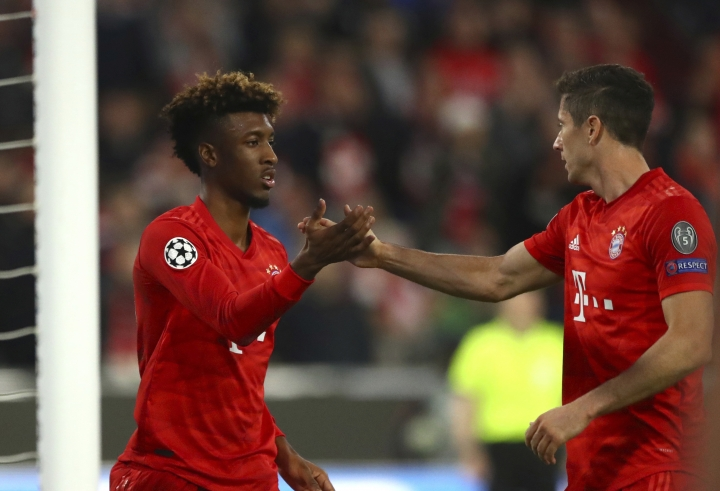 Bayern's Kingsley Coman, left, celebrates with Bayern's Robert Lewandowski after scoring his side's opening goal during the Champions League group B first round soccer match between FC Bayern Munich and Red Star Belgrade, in Munich, Germany, Wednesday, Sept. 18, 2019. (AP Photo/Matthias Schrader)