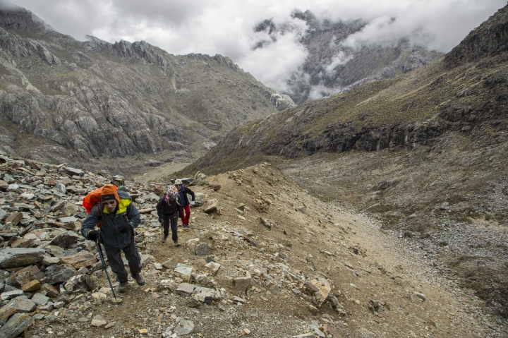 In this May 24, 2019 photo, scientists walk along a hilly path during an expedition to the Humbolt glacier, in Merida, Venezuela. While most of the planet's ice is stored in the polar regions, there also are glaciers in some mountainous regions of the tropics _ primarily in South America. (AP Photo/Jose Manuel Romero)