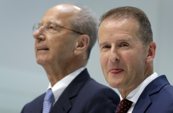 FILE - In this Friday, April 13, 2018, file photo, Herbert Diess, right, CEO of the Volkswagen, and Hans Dieter Poetsch, left, chairman of the board of directors of Volkswagen address the media during a press conference in Wolfsburg, Germany. German prosecutors say they have charged Volkswagen chief executive Herbert Diess and chairman Hans Dieter Poetsch, along with former CEO Martin Winterkorn, with market manipulation in connection with the diesel emissions scandal that erupted in 2015. (AP Photo/Michael Sohn, File)