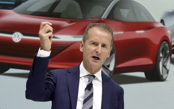 FILE - In this Aug. 1, 2018 file photo Herbert Diess, CEO of the Volkswagen car maker company, addresses the media during a press conference in Wolfsburg, Germany. German prosecutors say they have charged Volkswagen chief executive Herbert Diess and chairman Hans Dieter Poetsch, along with former CEO Martin Winterkorn, with market manipulation in connection with the diesel emissions scandal that erupted in 2015.(AP Photo/Michael Sohn, file)