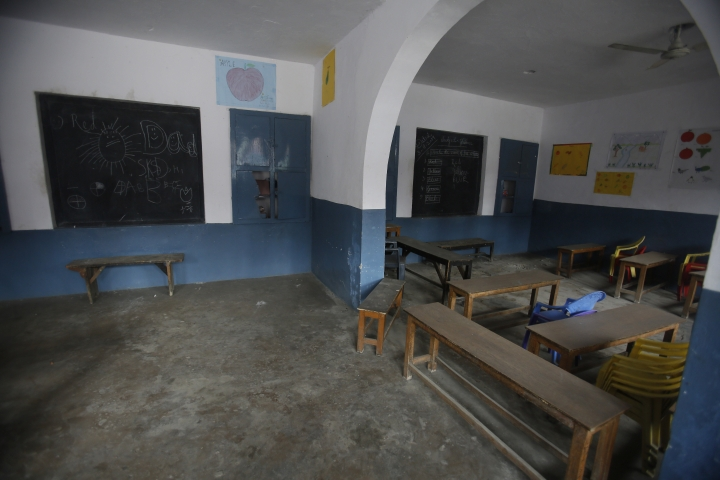 In this Tuesday, Sept. 17, 2019, photo, a classroom stands empty at a school in Srinagar, Indian controlled Kashmir. Kashmir's children have found refuge in makeshift schools amid the lockdown as dozens of ad hoc learning centers have popped up in homes and religious centers, and hundreds of students have signed up. The authorities earlier encouraged students to return to school but parents have largely remained unwilling to send their kids to educational institutes due to the restrictions in place. (AP Photo/Mukhtar Khan)
