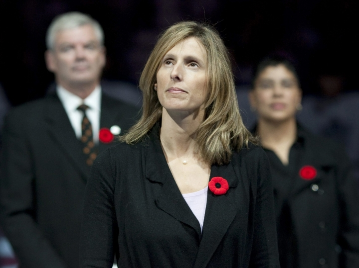 FILE - In this Nov. 6, 2010, file photo, Cammi Granato stands on center ice after being inducted into the Hockey Hall of Fame before an NHL game between the Toronto Maple Leafs and the Buffalo Sabres in Toronto. Seattle's expansion NHL franchise has hired former U.S. Olympic team captain Cammi Granato as a pro scout. Granato is one of a handful of women working on the hockey operations side of an NHL franchise and she is the only female pro scout currently in the league. (Chris Young/The Canadian Press via AP, File)