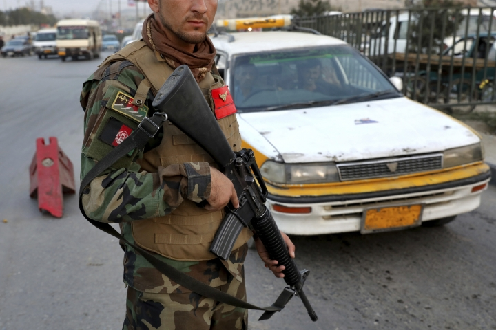 In this Tuesday, Sept. 24, 2019 photo, an Afghan National Army soldier stands guard at a checkpoint ahead of presidential elections scheduled for Sept. 28, in Kabul, Afghanistan. Roughly 9% of polling centers won't open due to insecurity. Afghanistan's Independent Election Commission requested security for 5,373 polling centers, but security agencies said 410 polling centers were impossible to secure and would be closed on Saturday. (AP Photo/Ebrahim Noroozi)
