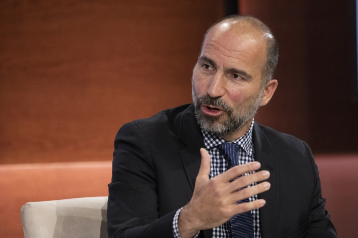 "FILE - In this Wednesday, Sept. 25, 2019, file photo Dara Khosrowshahi, CEO of Uber, speaks at the Bloomberg Global Business Forum in New York. Uber will begin cramming more services into its ride-hailing app as it explores ways to generate more revenue and finally turn a profit. The makeover announced Thursday, Sept. 26, will include force-feeding its food delivery service, ""Eats,"" into the Uber app that millions of people use to summon a ride. (AP Photo/Mark Lennihan, File)"