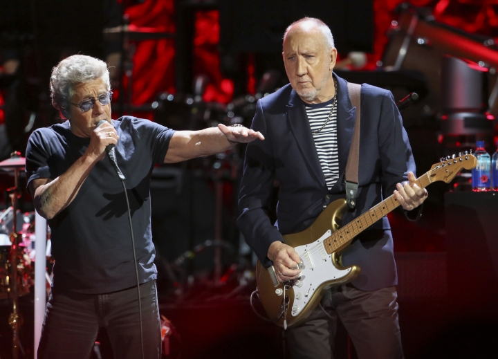 In this Wednesday, Sept. 18, 2019 photo, Roger Daltrey and Pete Townshend with The Who performs during the Moving On! Tour at State Farm Arena in Atlanta. The Who cut short a Houston concert after lead singer Daltrey lost his voice midway through the event. The band's next scheduled concert is Friday, Sept. 27, 2019, in Dallas. (Photo by Robb Cohen/Invision/AP, File)