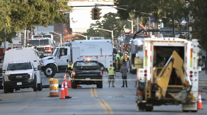 """Emergency personnel respond after a reported gas leak early Friday, Sept. 27, 2019 in Lawrence, Mass. About 100 people have been evacuated from their homes and two schools have been closed in response to a natural gas leak in the Massachusetts city affected a year ago by a series of gas explosions and fires. Lawrence Fire Chief Brian Moriarty said the leak in a high-pressure line was discovered around 3:15 a.m. Friday and that the volume of gas released was in the """"explosive range."""" No explosions or fires have been reported. (David L. Ryan/The Boston Globe via AP)"""