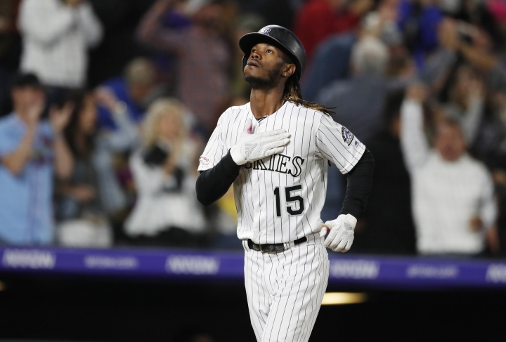 Colorado Rockies pinch hitter Raimel Tapia gestures as he circles the bases after hitting a grand slam off Milwaukee Brewers relief pitcher Jay Jackson in the sixth inning of a baseball game Friday, Sept. 27, 2019, in Denver. (AP Photo/David Zalubowski)