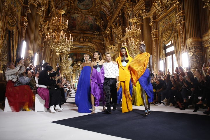 Designer Olivier Rousteing, center, accepts applause at the conclusion of the Balmain Ready To Wear Spring-Summer 2020 collection, unveiled during the fashion week, in Paris, Friday, Sept. 27, 2019. (AP Photo/Thibault Camus)