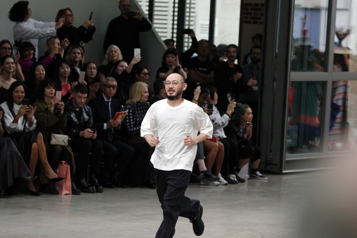 Designer Satoshi Kondo acknowledges the audience at the end of the Issey Miyake Ready To Wear Spring-Summer 2020 collection, unveiled during the fashion week, in Paris, Friday, Sept. 27, 2019. (AP Photo/Francois Mori)