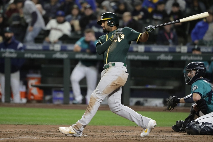 Oakland Athletics' Marcus Semien follows through on a line out to left field during the sixth inning of a baseball game against the Seattle Mariners, Friday, Sept. 27, 2019, in Seattle. (AP Photo/Ted S. Warren)