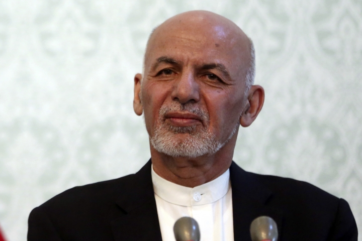 FILE - In this Nov. 6, 2018 file photo, Afghan President Ashraf Ghani, listens during a news conference with NATO Secretary General Jens Stoltenberg, at the presidential palace, in Kabul, Afghanistan. While there will be 18 names on the presidential ballot when Afghans go to the polls on Sept. 28 only five, including Ghani, have been campaigning after several suspended their campaigns believing a peace deal with the Taliban was imminent. (AP Photo/Massoud Hossaini)
