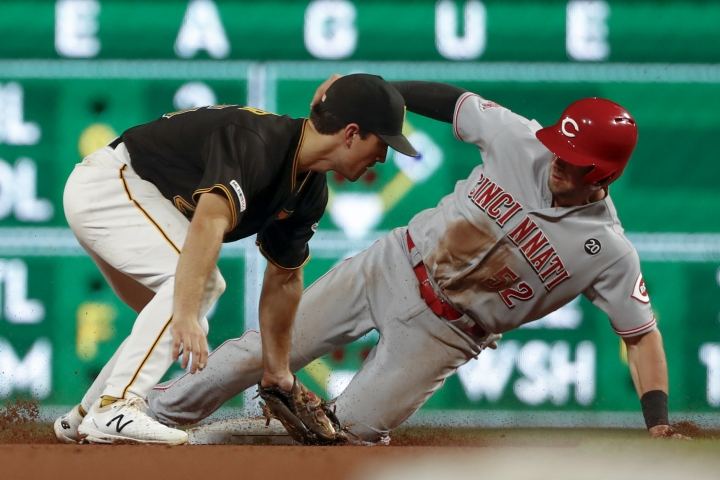 Cincinnati Reds' Kyle Farmer (52) steals second ahead of the tag by Pittsburgh Pirates shortstop Kevin Newman in the eighth inning of a baseball game, Saturday, Sept. 28, 2019, in Pittsburgh. (AP Photo/Keith Srakocic)