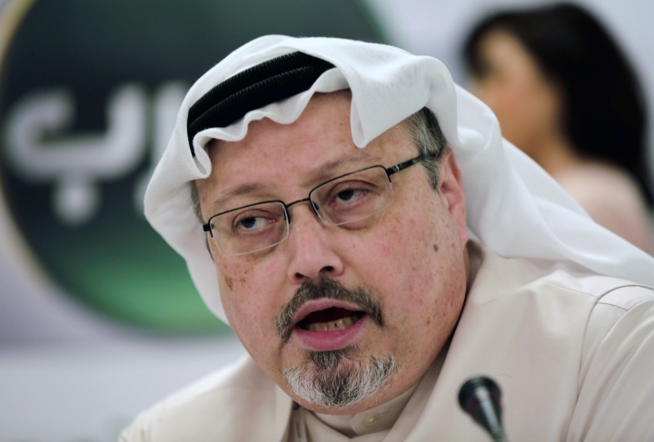 FILE - In this Dec. 15, 2014, file photo, Saudi journalist Jamal Khashoggi speaks during a press conference in Manama, Bahrain. Nearly one year has passed since the Oct. 2 killing of Khashoggi, whose body has still not been found, no one has been convicted and questions continue to linger over the crown prince's culpability. At the sidelines of the U.N. General Assembly, relatives of activists detained in Saudi Arabia, and Khashoggi's fiancée, wondered why those responsible haven't been punished. (AP Photo/Hasan Jamali, File)