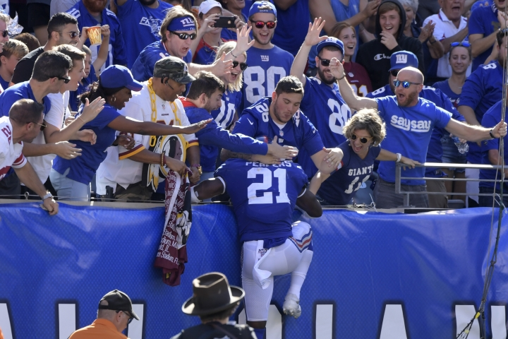 New York Giants free safety Jabrill Peppers celebrates his touchdown with Giants fans during the second half of an NFL football game against the Washington Redskins, Sunday, Sept. 29, 2019, in East Rutherford, N.J. (AP Photo/Bill Kostroun)
