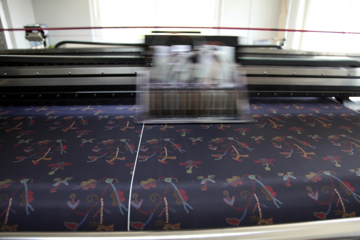 In this Tuesday, Sept. 10, 2019, a silk digital printing machine operates at Silk Tsiakiris Company in Soufli, northeastern Greece. Greece's financial crisis nearly snuffed out the country's centuries-old silk manufacturing tradition, but the end of the crippling recession has raised demand for fashion products and silk produced by a remote border town. (AP Photo/Iliana Mier)