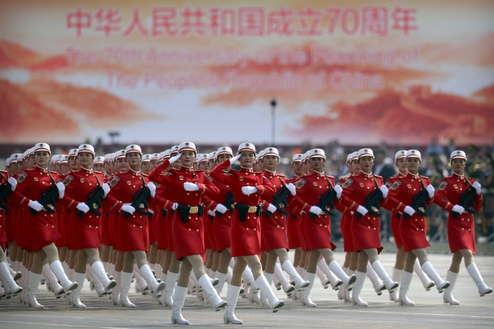 Chinese female militia members march in formation during a parade to commemorate the 70th anniversary of the founding of Communist China in Beijing, Tuesday, Oct. 1, 2019. Trucks carrying weapons including a nuclear-armed missile designed to evade U.S. defenses rumbled through Beijing as the Communist Party celebrated its 70th anniversary in power with a parade Tuesday that showcased China's ambition as a rising global force. (AP Photo/Mark Schiefelbein)