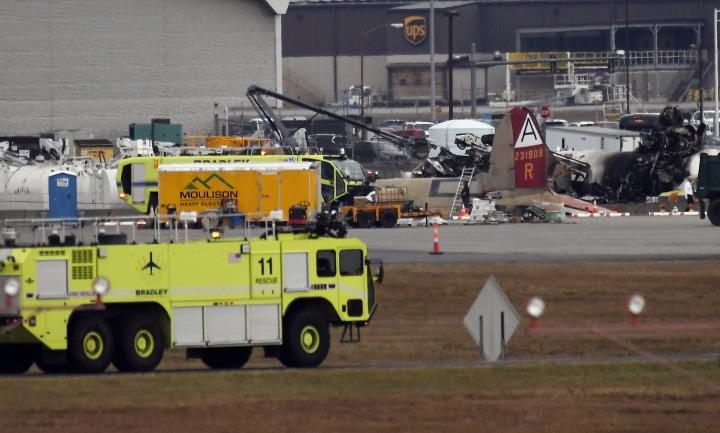 Emergency crews respond to where a World War II-era bomber B-17 plane crashed at Bradley International Airport in Windsor Locks, Conn., Wednesday, Oct. 2, 2019. (AP Photo/Jessica Hill)