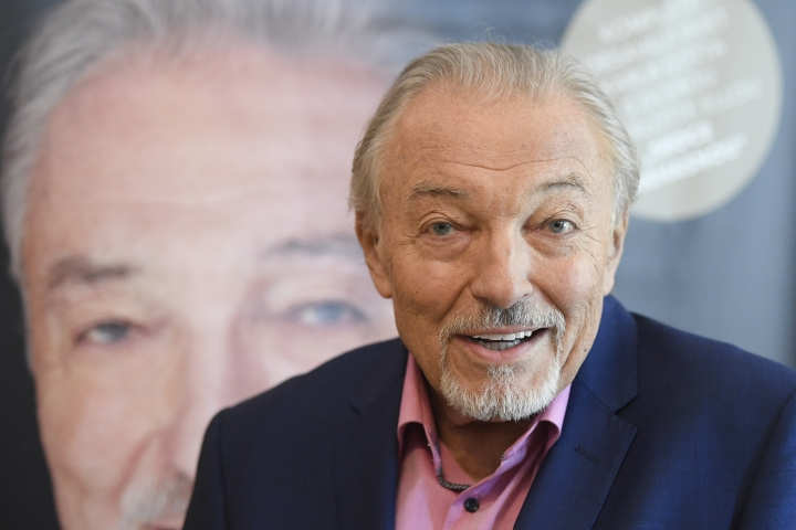 FILE - This June 18, 2019 file photo shows most popular Czech pop singer Karel Gott as he gives an interview to the Czech News Agency (CTK), in Prague, Czech Republic. Gott died at 80 on Tuesday, October 1, before midnight at home in his family circle, his spokeswoman Aneta Stolzova said Wednesday, Oct. 2, 2019. (Ondrej Deml/CTK via AP) *** SLOVAKIA OUT ***