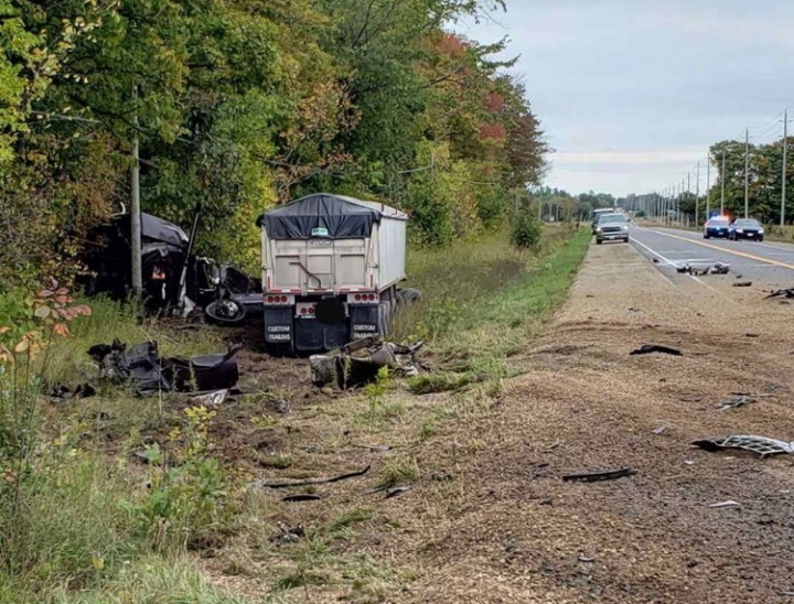 This Monday, Sept. 30, 2019 photo, released by the Ontario Provincial Police, shows the aftermath of a fatal crash involving a car and a transport truck near Shelburne, Ontario. Canadian police say the Jamaican dancehall reggae artist and actor known as Louie Rankin died in the car crash involving a transport truck. (Ontario Provincial Police/The Canadian Press via AP)