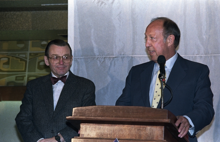 FILE - In this March 15, 1988, file photo, Cardinals owner Bill Bidwell, left, looks on as NFL commissioner Pete Rozelle announces that the Cardinals will move from St. Louis to Phoenix, Ariz., during a press conference in Phoenix. William V. Bidwill, who owned the NFL's Cardinals franchise in three cities, has died. He was 88. The team announced that Bidwill passed away Wednesday, Oct. 2, 2019. A cause of death wasn't immediately given.(AP Photo/Rob Schumacher, File)