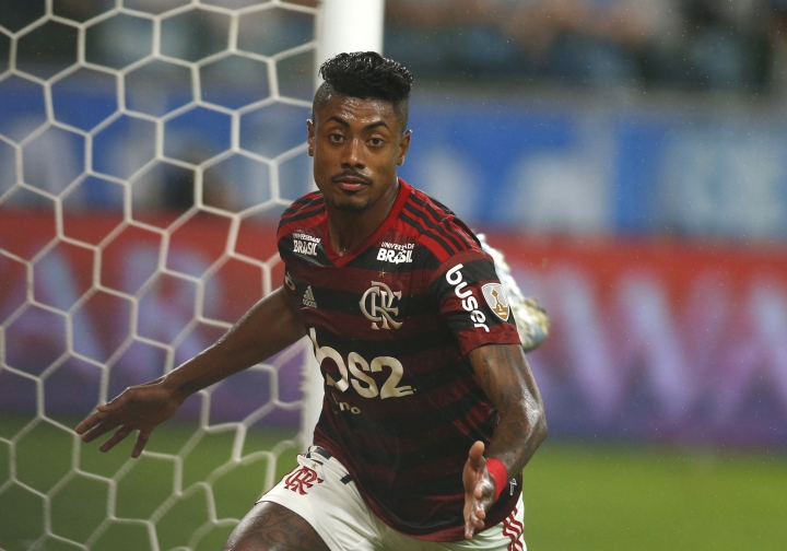 Bruno Henrique of Brazil's Flamengo, celebrates scoring his side's first goal against Brazil's Gremio during a Copa Libertadores semifinal first leg soccer match at the Gremio Arena in Porto Alegre, Brazil, Wednesday, Oct. 2, 2019. (AP Photo/Edison Vara)