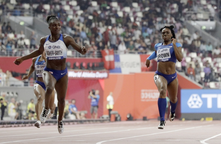 Dina Asher-Smith of Great Britain, left, crosses the line to win the gold medal in the women's 200 meter final ahead of Brittany Brown, of the United States, silver, at the World Athletics Championships in Doha, Qatar, Wednesday, Oct. 2, 2019. (AP Photo/Petr David Josek)