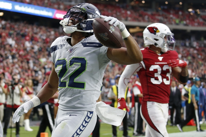 Seattle Seahawks running back C.J. Prosise (22) scores a touchdown against the Arizona Cardinals during the second half of an NFL football game, Sunday, Sept. 29, 2019, in Glendale, Ariz. (AP Photo/Ross D. Franklin)