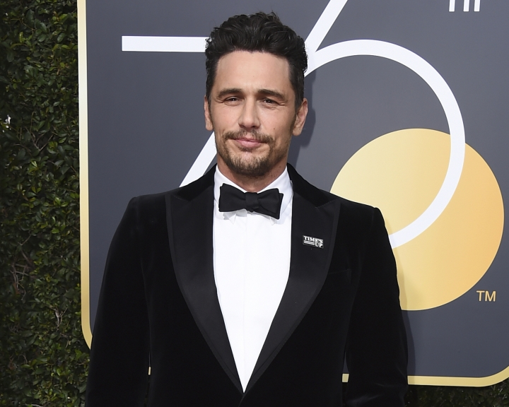 FILE - In this Jan. 7, 2018 file photo, James Franco arrives at the 75th annual Golden Globe Awards in Beverly Hills, Calif. Two actresses have sued Franco and his former acting and film school, saying they were pushed into gratuitous and exploitative sexual situations as his students. (Photo by Jordan Strauss/Invision/AP, File)