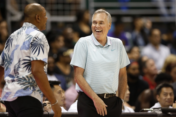 Los Angeles Clippers' head coach Doc Rivers, left, and Houston Rockets' head coach Mike D'Antoni talk on the sidelines during the second quarter of an NBA preseason basketball game, Thursday, Oct 3, 2019, in Honolulu. (AP Photo/Marco Garcia)