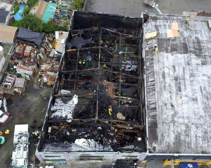 FILE - This undated file photo provided by the City of Oakland shows the burned warehouse after the deadly fire that broke out on Dec. 2, 2016, in Oakland, Calif. Derick Almena who was in charge of the artists' work-live warehouse that burned three years ago, killing 36, is due back in court Friday, Oct. 4, 2019, for a possible retrial. Almena's previous trial ended in a hung jury. (City of Oakland via AP, File)