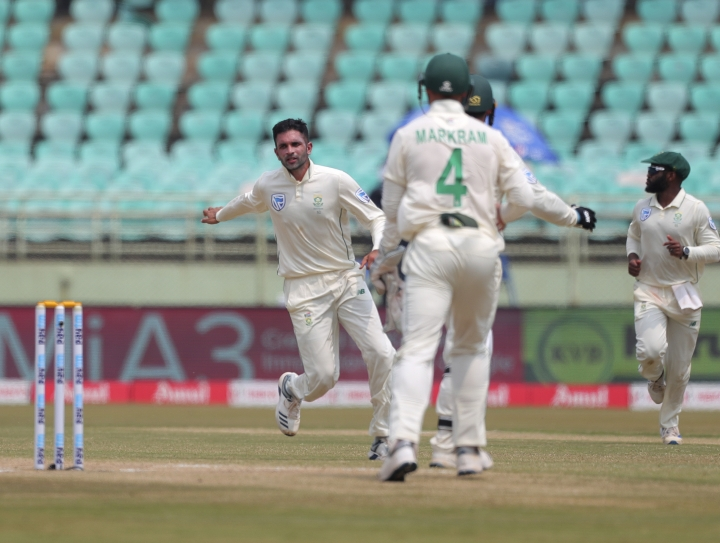 South Africa's bowler Keshav Maharaj, left, celebrates after dismissing India's Mayank Agarwal during the fourth day of the first cricket test match against India in Visakhapatnam, India, Saturday, Oct. 5, 2019. (AP Photo/Mahesh Kumar A.)