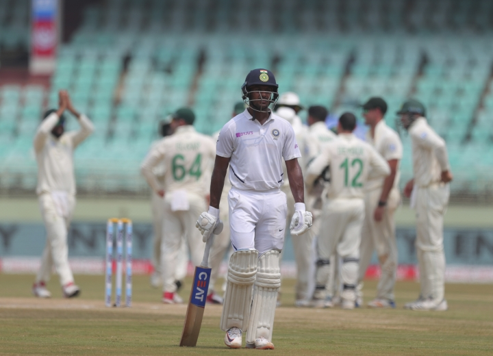 India's Mayank Agarwal leaves after being dismissed by South Africa's Keshav Maharaj during the fourth day of the first cricket test match against South Africa in Visakhapatnam, India, Saturday, Oct. 5, 2019. (AP Photo/Mahesh Kumar A.)
