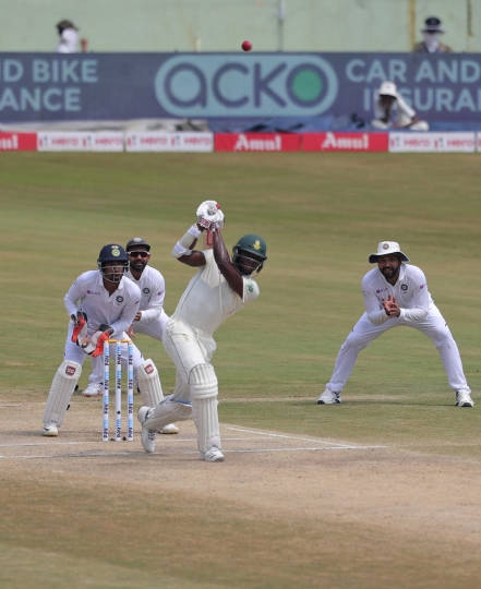 South Africa's Kagiso Rabada bats during the fourth day of the first cricket test match against India in Visakhapatnam, India, Saturday, Oct. 5, 2019. (AP Photo/Mahesh Kumar A.)