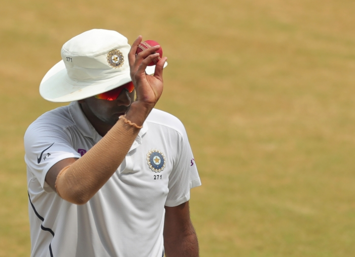 Indian cricketer Ravichandran Ashwin holds the ball up while leaving the ground at the end of the first innings during the fourth day of the first cricket test match against South Africa in Visakhapatnam, India, Saturday, Oct. 5, 2019. (AP Photo/Mahesh Kumar A.)