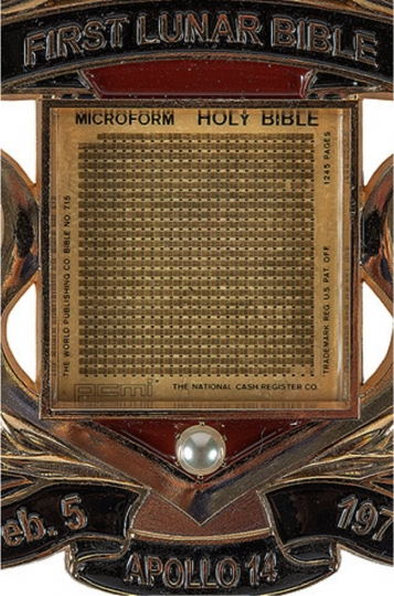 In this undated photo provided by the Museum of the Bible, a photo of the Lunar Bible on display at the museum. The museum has quietly replaced an artifact purported to be one of a handful of miniature Bibles that a NASA astronaut carried to the moon in 1971 after an expert questioned its authenticity. (Museum of the Bible Collection via AP)