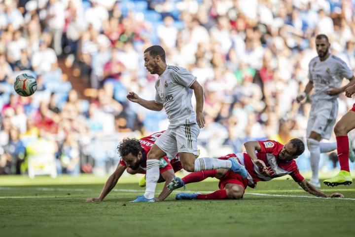 Real Madrid's Eden Hazard scores during the Spanish La Liga soccer match between Real Madrid and Granada at the Santiago Bernarbeu stadium in Madrid, Saturday, Oct. 5, 2019. (AP Photo/Bernat Armangue)