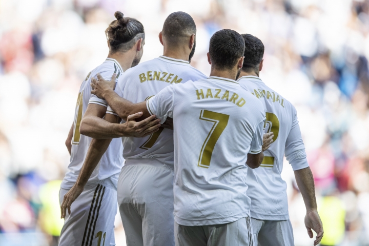 Real Madrid's Karim Benzema, second left, is congratulated by teammates after scoring during the Spanish La Liga soccer match between Real Madrid and Granada at the Santiago Bernarbeu stadium in Madrid, Saturday, Oct. 5, 2019. (AP Photo/Bernat Armangue)