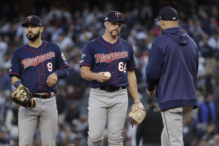 Minnesota Twins starting pitcher Randy Dobnak (68) hands the ball to manager Rocco Baldelli as he leaves the game during the third inning of Game 2 of an American League Division Series baseball game against the New York Yankees, Saturday, Oct. 5, 2019, in New York. (AP Photo/Frank Franklin II)