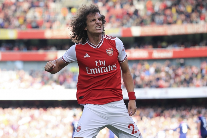 Arsenal's David Luiz celebrates after scoring his side's opening goal during the English Premier League soccer match between Arsenal and Bournemouth at the Emirates stadium in London, Sunday, Oct. 6, 2019. (AP Photo/Leila Coker)