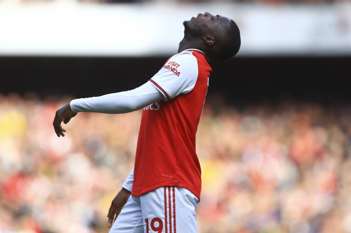 Arsenal's Nicolas Pepe looks up during the English Premier League soccer match between Arsenal and Bournemouth at the Emirates stadium in London, Sunday, Oct. 6, 2019. (AP Photo/Leila Coker)