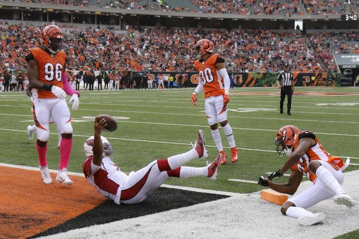 Arizona Cardinals quarterback Kyler Murray (1) leaps in for a touchdown against Cincinnati Bengals cornerback William Jackson (22) in the first half of an NFL football game, Sunday, Oct. 6, 2019, in Cincinnati. (AP Photo/Gary Landers)