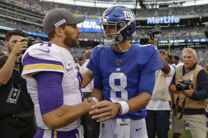 Minnesota Vikings quarterback Kirk Cousins (8) and New York Giants quarterback Daniel Jones (8) talk after playing each other in an NFL football game, Sunday, Oct. 6, 2019, in East Rutherford, N.J. (AP Photo/Adam Hunger)