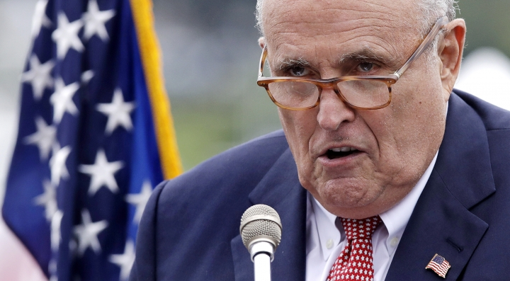 FILE - This Aug. 1, 2018, file photo shows Rudy Giuliani, an attorney for President Donald Trump, in Portsmouth, N.H. As Giuliani was pushing Ukrainian officials in the spring of 2019 to investigate one of Donald Trump's main political rivals, a group of individuals with ties to the president and his personal lawyer were also active in the former Soviet Republic. (AP Photo/Charles Krupa, File)