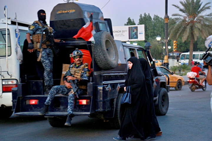 Iraqi Federal police deployed in Sadr City, Baghdad, Iraq, Monday, Oct. 7, 2019. Iraq's prime minister on Monday ordered the police to replace the army in Sadr City, a heavily populated Shiite neighborhood of Baghdad where dozens of people were killed or wounded in weekend clashes stemming from anti-government protests. (AP Photo/Hadi Mizban)